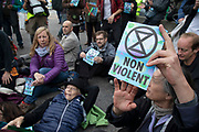 Extinction Rebellion non-violent disruption by people of all ages outside City Airport on 10th October 2019 in London, England, United Kingdom. The protest is against the climate and pollution impact of the government's plans for airport expansion which will potentially double the amount of flights coming from City Airport. Extinction Rebellion is a climate change group started in 2018 and has gained a huge following of people committed to peaceful protests. These protests are highlighting that the government is not doing enough to avoid catastrophic climate change and to demand the government take radical action to save the planet.