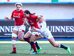Jasmine Joyce of Wales is tackled by Zoe Harrison of England<br /> <br /> Photographer Simon King/Replay Images<br /> <br /> Six Nations Round 3 - Wales Women v England Women - Sunday 24th February 2019 - Cardiff Arms Park - Cardiff<br /> <br /> World Copyright © Replay Images . All rights reserved. info@replayimages.co.uk - http://replayimages.co.uk