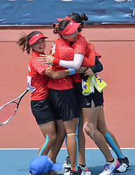 PALEMBANG, Sept. 1, 2018  Players of team China celebrate after winning the match against Indonesia during soft tennis women's team quarterfinal at the 18th Asian Games 2018 in Palembang, Indonesia on Sept. 1, 2018. China won 2-0. (Credit Image: © Veri Sanovri/Xinhua via ZUMA Wire)