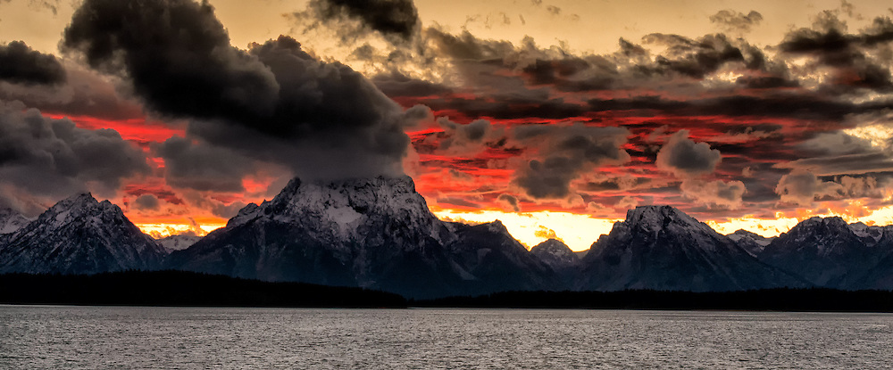 Dramatic afternoon storm clouds over Mount Moran and other peaks in the Teton Range
