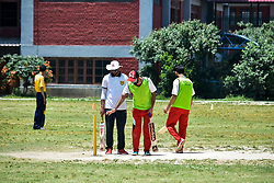June 30, 2019 - Srinagar, J&K, India - An umpire assists a visually impaired batsman during the match in Srinagar..The first ever blind cricket tournament was organized by J&K Handicapped Association and Disable People's Trust for the visually-impaired players here in Srinagar. The motive behind this tournament is to encourage players to take part in sports events and boost their morals so that they can also make a career in sports. (Credit Image: © Saqib Majeed/SOPA Images via ZUMA Wire)