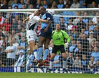 Photo: Jo Caird<br /> Coventry City v Wigan Athletic<br /> Nationwide Football League Div 1<br /> 27/09/2003.<br /> <br /> Matt Jackson, wigan contests Dele Adebola