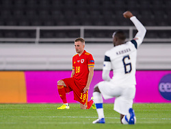HELSINKI, FINLAND - Thursday, September 3, 2020: Wales' Joseff Morrell kneels down (takes a knee) in support of the Black Lives Matter movement before the UEFA Nations League Group Stage League B Group 4 match between Finland and Wales at the Helsingin Olympiastadion. (Pic by Jussi Eskola/Propaganda)