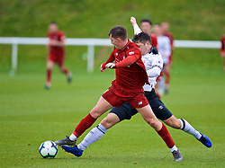 DERBY, ENGLAND - Friday, March 8, 2019: Liverpool's Ben Woodburn and Derby County's Ethan Wassall during the FA Premier League 2 Division 1 match between Derby County FC Under-23's and Liverpool FC Under-23's at the Derby County FC Training Centre. (Pic by David Rawcliffe/Propaganda)