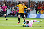 Scott Brown, the Wycombe Wanderers goalkeeper saves at the feet of Padraig Amond of Newport county. EFL Skybet football league two match, Newport county v Wycombe Wanderers at Rodney Parade in Newport, South Wales on Saturday 9th September 2017.<br /> pic by Andrew Orchard, Andrew Orchard sports photography.