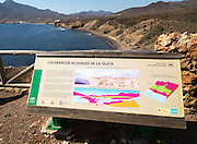 Information panel about geology,  La Isleta,  Cabo de Gata national park, Almeria, Spain