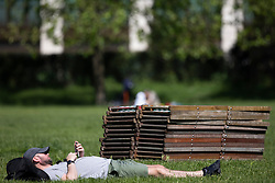 © Licensed to London News Pictures. 02/06/2021. London, UK. A man relaxes during sunny weather in Green Park in Central London. Temperatures are expected to rise with highs of 28 degrees forecasted for parts of London and South East England today . Photo credit: George Cracknell Wright/LNP