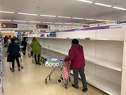 © Licensed to London News Pictures. 14/03/2020. Langley, UK. Shelves empty of toilet roll shortly after opening at 7am at  Sainsbury's on Ladbroke Grove in west London. New cases of the COVID-19 strain of Coronavirus are being reported daily as the government outlines it's plans for delaying the outbreak. Photo credit: Ben Cawthra/LNP