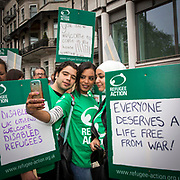 Young people from Syria and Libya supported by Refugee Action get a selfie at the demo. Refugee Action is one of the 60 organisations supporting the 2016 Refugees Welcome Here march, calling on the government to do more to welcome refugees here in the UK. The march was organised by Solidarity with Refugees and held on the 17th of September 2016, Westminster, Central London, UK.