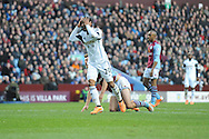 Swansea City's Jonathan de Guzman reacts after he's missed an easy chance to score during the Barclays Premier league, Aston Villa v Swansea city at Villa Park in Birmingham, England on Saturday 28th Dec 2013. <br /> pic by Jeff Thomas, Andrew Orchard sports photography.