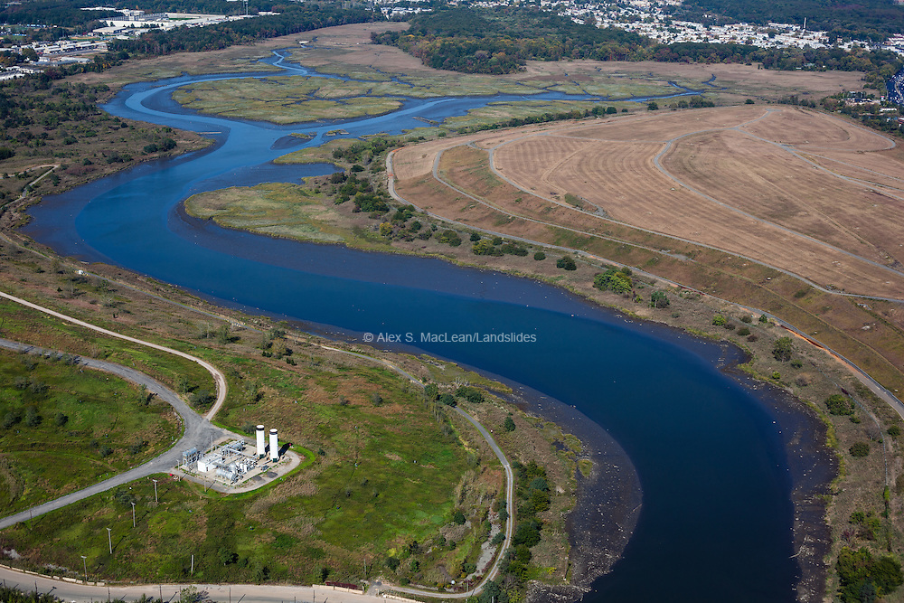 A waterway weaves through Fresh Kills Landfill, once the largest landfill in the world. It is now undergoing transformation into reclaimed wetlands, recreational facilities and landscaped public parkland. The project is designed by James Corner Operations.