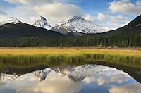Peaks of the Spray Range reflected in still waters of the Smuts Creek wetlands, Peter Loughheed Provincial Park, Kananaskis Country, Alberta