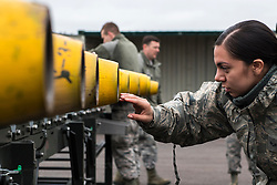 Senior Airman Angelica Melendez, 2nd Munitions Squadron conventional maintenance crew chief deployed from Barksdale Air Force Base, La., inspects the nose of a Guided Bomb Unit - 38 before its assembly at RAF Fairford, England, March 21, 2019. Melendez was the lead crew chief for the assembly and her primary task was to ensure each step of the process was followed correctly. (U.S. Air Force photo by Airman 1st Class Tessa B. Corrick)