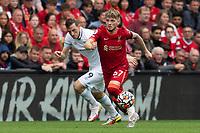 Football - 2021 / 2022 Premier League - Liverpool vs Burnley - Anfield - Saturday 21st August 2021<br /> <br /> <br /> <br /> Liverpool's Harvey Elliott under pressure from Burnley's Chris wood