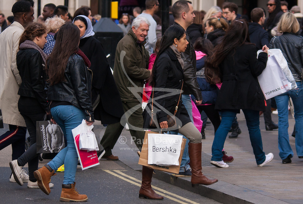 "London, December 23rd 2014. Dubbed by retailers as the ""Golden Hour"" thousands of shoppers use their lunch hour to do some last minute Christmas shopping in London's West End. PICTURED: Shoppers carry their many bags as retailers rake in the Christmas pounds."