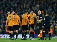 Football - 2019 / 2020 Premier League - Liverpool vs. Wolverhampton Wanderers<br /> <br /> Conor Coady of Wolves and his team argue with referee Anthony Taylor after VAR disallows a Wolves equaliser late in the frst half, at Anfield.<br /> <br /> COLORSPORT/ALAN MARTIN