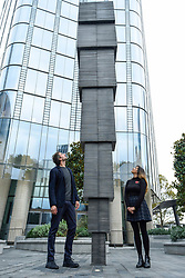 "© Licensed to London News Pictures. 05/11/2019. LONDON, UK. Artist Idris Khan and Cllr Rebecca Lury from Southwark Council at the preview of ""65,000 Photographs"" by Idris Khan, an aluminium and steel structure 8m tall, rising skywards in constituent blocks growing in size in relation to dimensions of standard photographic prints.  Unveiled at One Blackfriars, the artwork was commissioned by London Borough of Southwark as part of the One Blackfriars Public Art programme.  Photo credit: Stephen Chung/LNP"