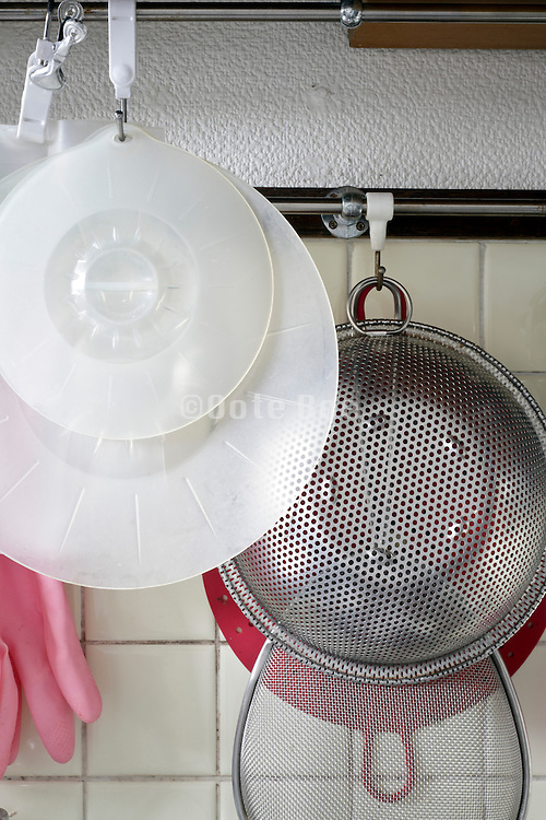 detail of domestic kitchen and cooking utensils hanging