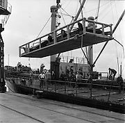 31/07/1962<br /> 07/31/1962<br /> 31 July 1962<br /> Oil drilling equipment arrives at North Wall, Dublin. Image shows unloading of oil drilling machinery for Ambassador Irish oil. Some of the equipment being lowered to the quay.