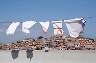 School shirts on Clothesline, Complexo do Alemão 2006. <br /> Part of the series Viver no Meio do Barulho (Living in the Middle of the Noise)