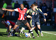 Nigel Atangana (4) of Exeter City commits a foul  during the EFL Sky Bet League 2 match between Exeter City and Stevenage at St James' Park, Exeter, England on 23 January 2021.