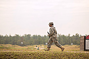 A woman Drill Sergeant candidate runs to position at the weapons range at the US Army Drill Instructors School Fort Jackson during weapons training September 26, 2013 in Columbia, SC. While 14 percent of the Army is women soldiers there is a shortage of female Drill Sergeants.