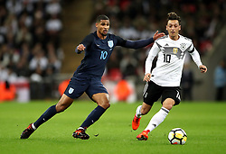 England's Ruben Loftus-Cheek (left) and Germany's Mesut Ozil (right) battle for the ball during the International Friendly match at Wembley Stadium, London.