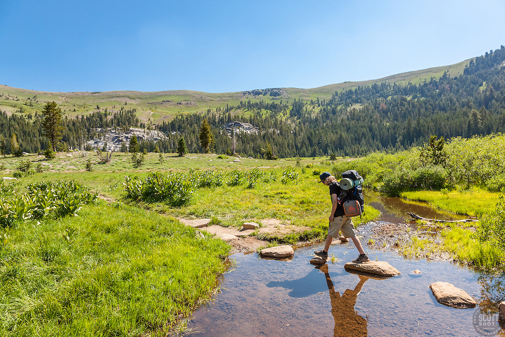 """""""Hiking the Pacific Crest Trail 1"""" - Photograph of a teenager hiking with a backpack on the Pacific Crest Trail at Lower Castle Creek in Tahoe."""