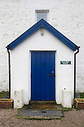 Front entrance doorway of Old Ferry House, now a remote self-catering house at Grasspoint, Loch Don, Isle of Mull, Scotland. Iron piles lean against a dry stone wall at the rear of Old Ferry House, now a remote self-catering house at Grasspoint, Loch Don, Isle of Mull, Scotland. Until 1881 a regular packet boat operated between Oban and Grass Point. This was replaced that year by a daily steamer service from Oban to Tobermory. Until that time, cattle from Rum and Eigg were transported by boat to Croig on Mull's north coast, and then driven across the island to Grass Point, on their way to the mainland. Parts of the old drover's route are still visible. The old stone quay is no longer used, except by occasional leisure craft. Grass Point means 'the field of the rock' in Gaelic...(http://www.isleofmullcottages.com/old_ferry_house.htm)