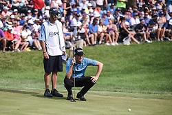 August 12, 2018 - Town And Country, Missouri, U.S - WEBB SIMPSON from Charlotte North Carolina, USA and his caddy line up the putt on the 18th green during round four of the 100th PGA Championship on Sunday, August 12, 2018, held at Bellerive Country Club in Town and Country, MO (Photo credit Richard Ulreich / ZUMA Press) (Credit Image: © Richard Ulreich via ZUMA Wire)