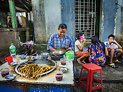 27 OCTOBER 2015 - YANGON, MYANMAR: A food vendor at Aungmingalar Jetty in Yangon. The jetty is one of the numerous crossing points that bring people from the suburbs on the other side of the river into Yangon.    PHOTO BY JACK KURTZ