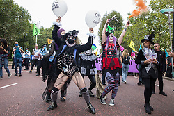 London, UK. 3rd September, 2020. A troupe of clowns joins fellow climate activists from Extinction Rebellion at a 'Carnival of Corruption' protest against the government's facilitation and funding of the fossil fuel industry. Extinction Rebellion activists are attending a series of September Rebellion protests around the UK to call on politicians to back the Climate and Ecological Emergency Bill (CEE Bill) which requires, among other measures, a serious plan to deal with the UK's share of emissions and to halt critical rises in global temperatures and for ordinary people to be involved in future environmental planning by means of a Citizens' Assembly.