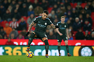 Nicolas Otamendi of Manchester City in action.Premier league match, Stoke City v Manchester City at the Bet365 Stadium in Stoke on Trent, Staffs on Monday12th March 2018.<br /> pic by Andrew Orchard, Andrew Orchard sports photography.