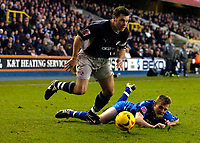 Photo: Alan Crowhurst.<br />Millwall v Reading. Coca Cola Championship. 17/12/2005. Graeme Murty (L) leaves the Millwall defence behind.