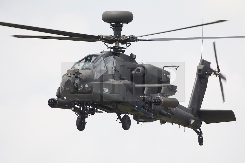 © Licensed to London News Pictures. 12/07/2014. RAF Fairford UK. An Army Air Corp Apache Performs at the Royal International Air Tattoo at RAF Fairford. Photo credit : Ian Schofield/LNP