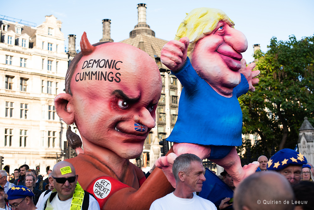 Puppets of Boris Johnson and chief adviser Dominic Cummings. Demonic Cummings: Get Brexit done reads the text on the puppets.