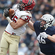 NEW HAVEN, CONNECTICUT - NOVEMBER 18:  Luke Hutton #35 of Harvard intercepts a pass intended for Jaeden Graham #46 of Yale during the Yale V Harvard, Ivy League Football match at the Yale Bowl. Yale won the game 24-3 to win their first outright league title since 1980. The game was the 134th meeting between Harvard and Yale, a historic rivalry that dates back to 1875. New Haven, Connecticut. 18th November 2017. (Photo by Tim Clayton/Corbis via Getty Images)