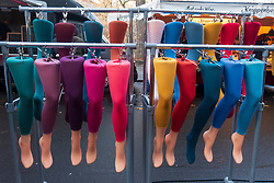 Rows of colourful tights for sale at outdoor weekend market in Prenzlauer Berg Berlin, Germany