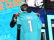28 April 2016: Ole Miss Rebels Laremy Tunsil walks on stage and poses with his jersey after being drafted as 13th Pick by the Miami Dolphins in the first round of the 2016 NFL Draft, held at the Auditorium Theatre, in Chicago IL.  (Photo By Robin Alam/Icon Sportswire)
