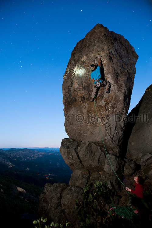 """Tim Terry climbing """"The Chief"""" (5.10c) under star light at The Far Side on Mt. St. Helena above Napa Valley, in Robert Louis Stevenson State Park, Calistoga, California"""