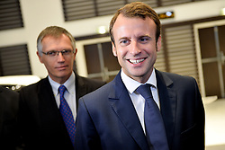 French Economy and Industry Minister Emmanuel Macron meets French carmaker PSA Peugeot Citroen Chairman of the Managing Board Carlos Tavares during a visit at the PSA headquarters in Paris on September 30, 2014. Photo by Nicolas Gouhier/ABACAPRESS.COM