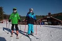 Sara and Ella go to the Ramrod Quad for Ella's lesson at Gunstock Mountain on Friday.  (Karen Bobotas Photo/for The Laconia Daily Sun)