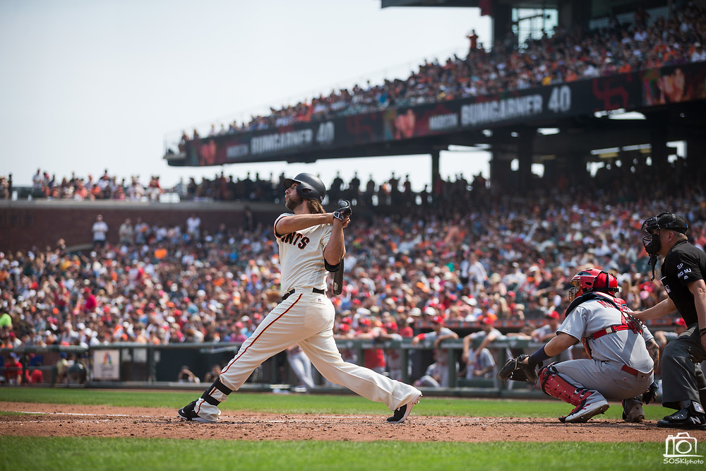San Francisco Giants starting pitcher Madison Bumgarner (40) watches the ball as he hits a solo home run against the St. Louis Cardinals at AT&T Park in San Francisco, California, on September 3, 2017. (Stan Olszewski/Special to S.F. Examiner)