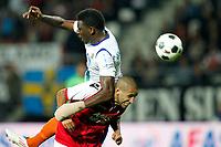 ALKMAAR - AZ - Aalesunds, voetbal,  seizoen 2011-2012, 25-08-2011, Europa League, AFAS Stadion, 6-0, Aalesunds speler Solomon Okoronkwo (l) en AZ speler Simon Poulsen (r) in duel.