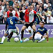 NLD/Rotterdam/20100919 - Voetbalwedstrijd Feyenoord - Ajax 2010, Ron Vlaar in duel met Mounir El Hamdaoui en Eyong Enoh