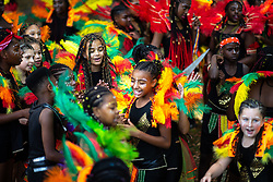 "© Licensed to London News Pictures . 11/08/2018. Manchester , UK . Dance Troop "" JET BLACK "" . The annual Moss Side Caribbean Carnival procession , celebrating dance , music and Afro-Caribbean culture , which passes in a loop from Alexandra Park and through the streets of Moss Side . Photo credit : Joel Goodman/LNP"
