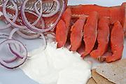 Den røkte røya fra Tydalsfisk er et produkt i verdensklasse og ble kåret til beste produkt på Trøndersk matmesse. Men juryen har ikke smakt rakfisken til den lille bedriften på Lauvøya. Foto: Bente Haarstad Fermented freshwater fish, rakfisk. A tradition in Norway. Served with sourcream, raw onions, potetoes, flat bread, bear and akkevit (aqva vitae).