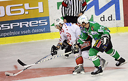 Tomo Hafner of Jesenice and Pasi Petrilainen of Olimpija at ice hockey match ZM Olimpija vs  Acroni Jesencie in third round of final of Slovenian National Championship,  on April 8, 2008 in Arena Tivoli, Ljubljana, Slovenia. Acroni Jesenice won the game 1:2 and lead the series 3:0.  (Photo by Vid Ponikvar / Sportal Images)