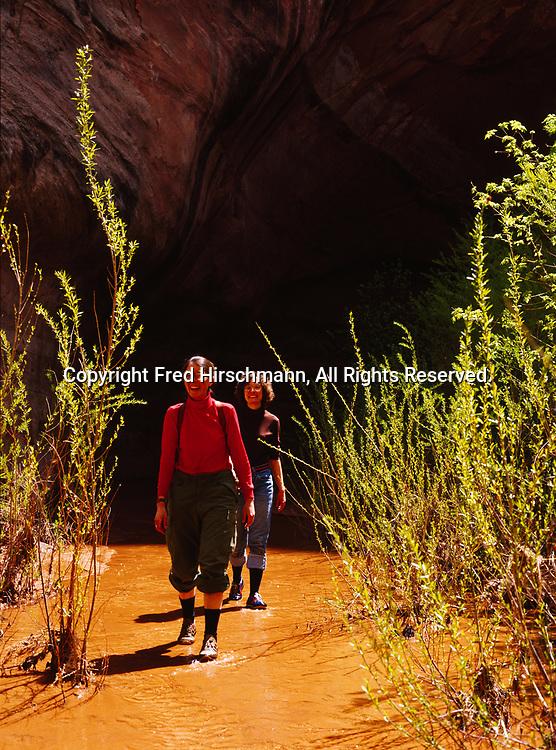 Cheryl Bloethe and Jane Schnoor hiking in Davis Gulch, Escalante River Basin, Glen Canyon National Recreation Area, Utah.