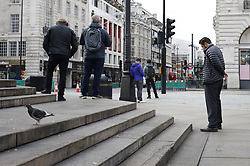 © Licensed to London News Pictures. 11/11/2020. London, UK. A two minute silence  is observed at Piccadilly Circus, central London at 11am in remembrance of the war dead. Scaled down Remembrance Sunday events were held because of the ongoing pandemic. Photo credit: Peter Macdiarmid/LNP